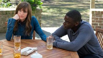 """Rose (ALLISON WILLIAMS) connects with boyfriend Chris (DANIEL KALUUYA) in Universal Pictures' """"Get Out,"""" a speculative thriller from Blumhouse (producers of """"The Visit,"""" """"Insidious"""" series and """"The Gift"""") and the mind of Jordan Peele.  When a young African-American man visits his white girlfriend's family estate, he becomes ensnared in a more sinister real reason for the invitation."""