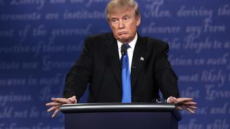 HEMPSTEAD, NY - SEPTEMBER 26:  Republican presidential nominee Donald Trump looks on during the Presidential Debate at Hofstra University on September 26, 2016 in Hempstead, New York.  The first of four debates for the 2016 Election, three Presidential and one Vice Presidential, is moderated by NBC's Lester Holt.  (Photo by Win McNamee/Getty Images)
