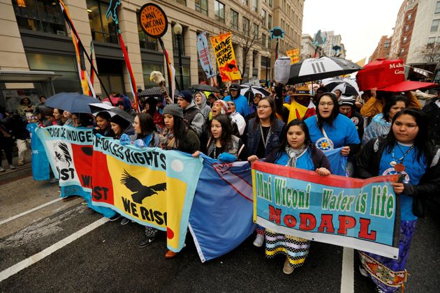 Members of the Standing Rock Sioux Nation and Indigenous leaders participate in a protest march and rally...
