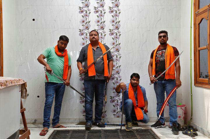 Members of the <em>Hindu Yuva Vahini</em>, a far-right vigilante group in Uttar Pradesh state, India.