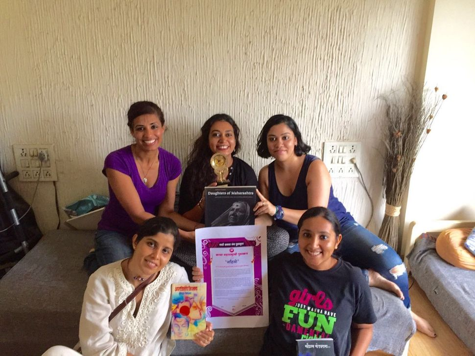 Sahiyo cofounders in Mumbai India displaying an award the organization received for their work on female genital cutting