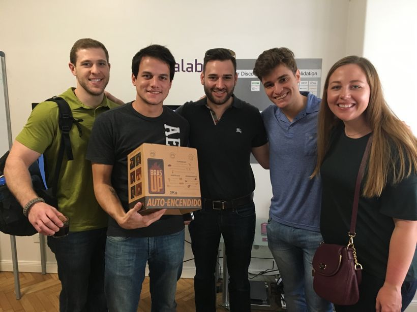 Weatherhead MBA students Alec Janda, Giancarlo DiFranco, and Michelle Miller with the BrasUp team at Scalabl