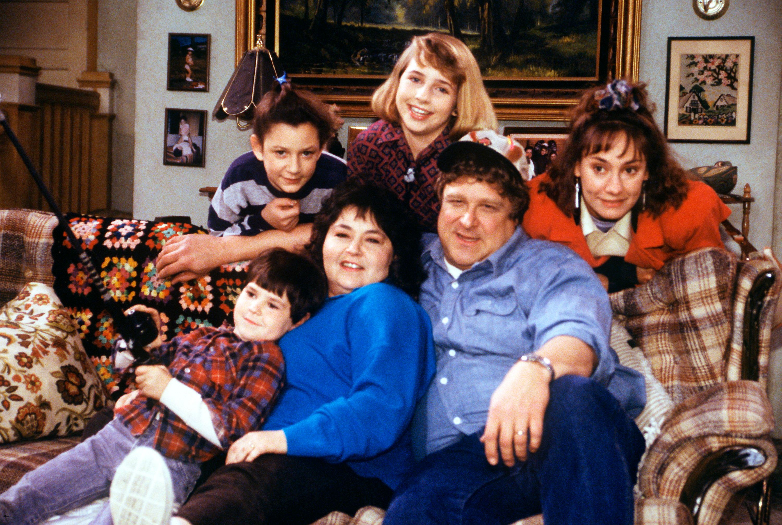 UNITED STATES - JANUARY 24:  ROSEANNE - 'The Monday Thru Friday Show' - Season One - 1/24/89, Roseanne (Roseanne Barr) and Dan (John Goodman) disagree about where to spend a romantic 15th anniversary; Darlene (Sara Gilbert, top left) found her paper route more than she could handle; Becky (Lecy Goranson, top center) refused to dissect a frog in biology class. Laurie Metcalf (Jackie) and Michael Fishman (D.J.) also starred.,  (Photo by ABC Photo Archives/ABC via Getty Images)