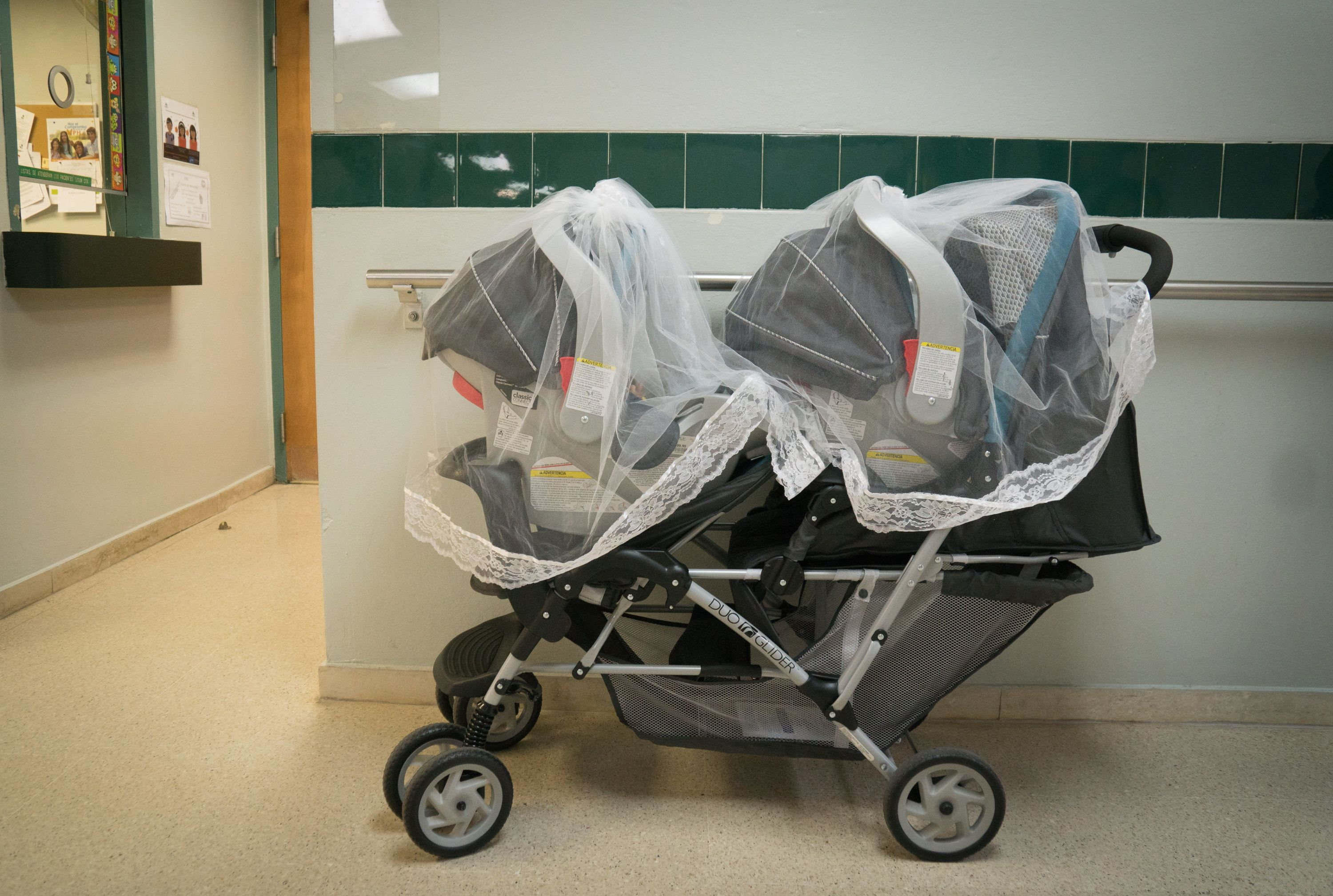 The mosquito net-covered stroller where 2-month-old twins Misael and Ismael Carrasquillo slept during a visit for regular vac
