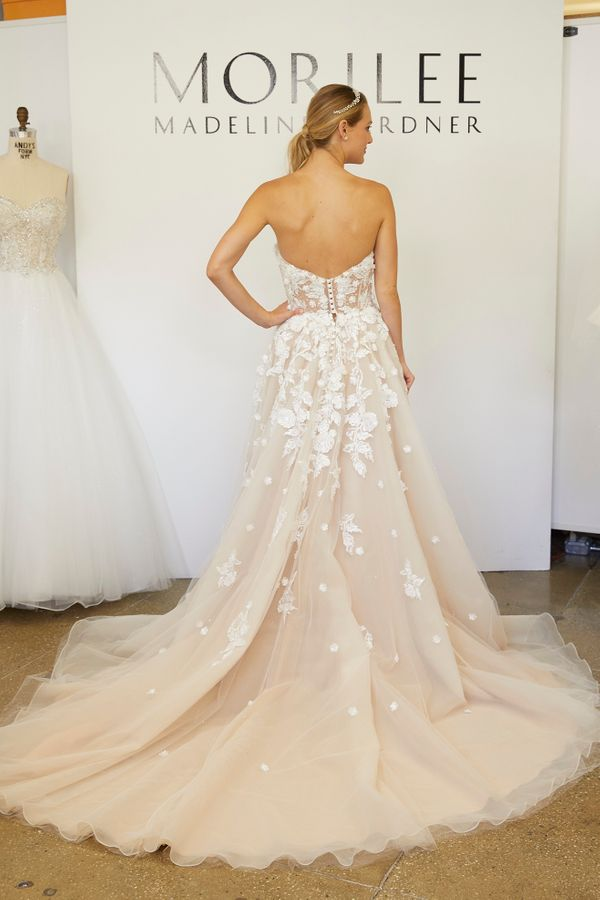 """<i><a href=""""https://www.morilee.com/browse/bridal-wedding-dresses/morilee/"""" target=""""_blank"""">Morilee By Madeline Gardner</a></"""