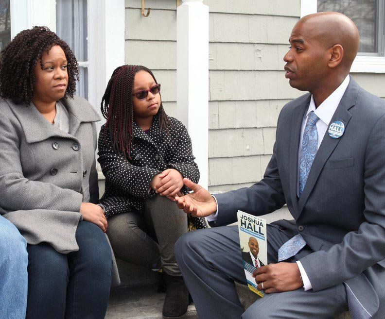 Joshua Hall right speaks to voters on the campaign trail He became the third Working Families Party candidate to win a legislature seat on Tuesday April 25 2017