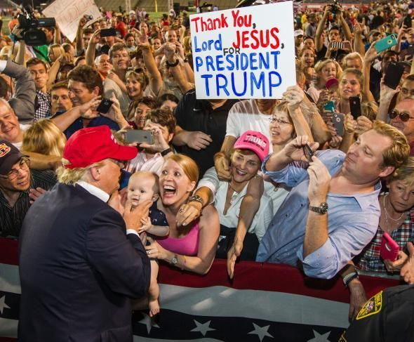 Donald Trump greets an enthusiastic  crowd of supporters on August 21, 2015 in Mobile, AL. The Terror Management Theory sugge