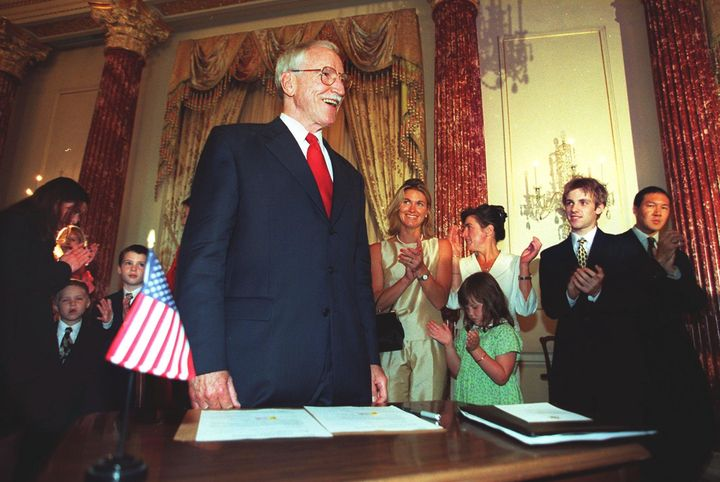 Friends and family applaud James Hormel after he's sworn in as the U.S. Ambassador to Luxembourg in 1999.