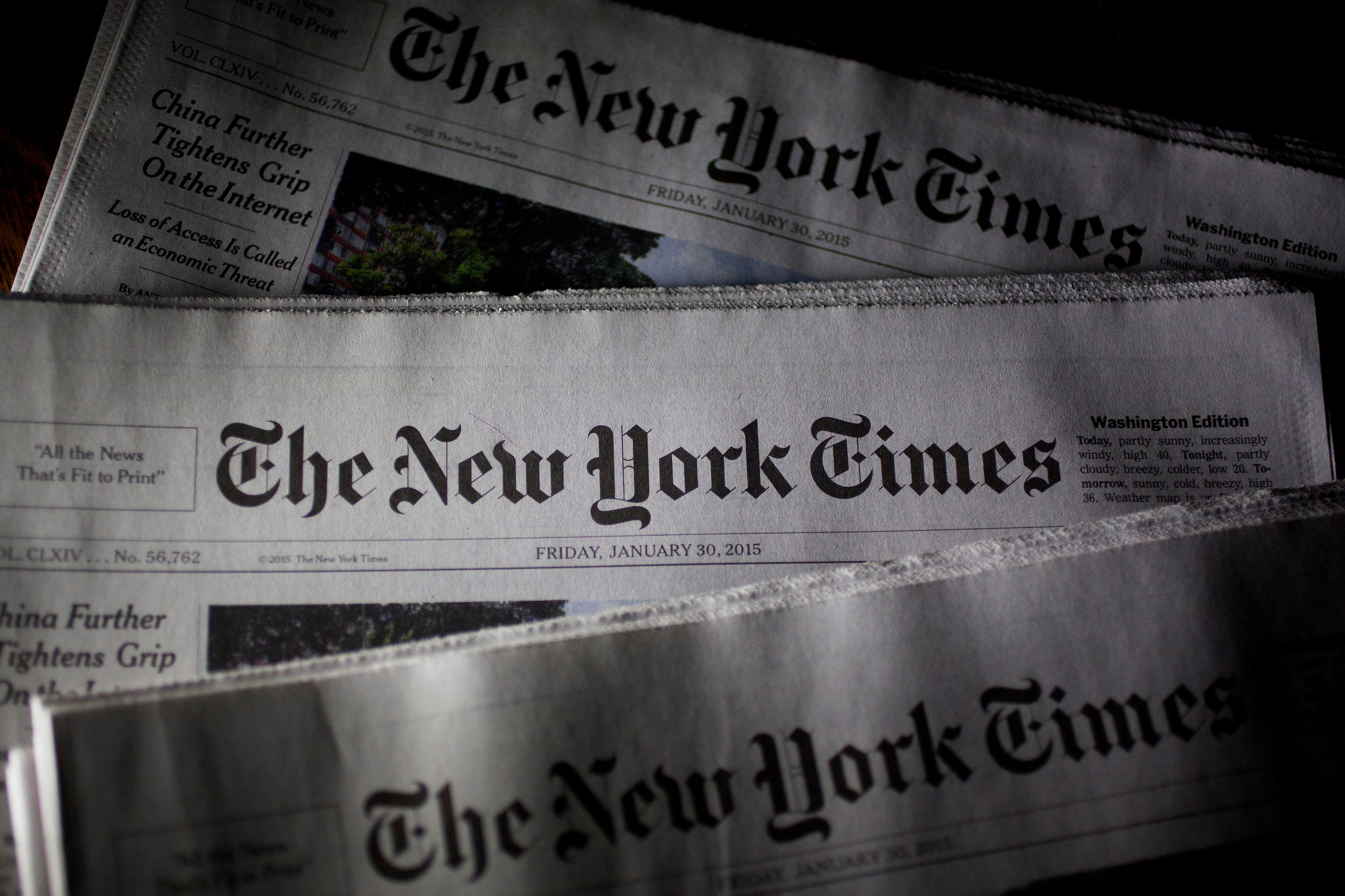 New York Times newspapers are arranged for a photograph in Washington, D.C., U.S., on Friday, Jan. 30, 2015. The New York Times Co. is expected to release fourth-quarter earnings on Feb. 3. Photographer: Andrew Harrer/Bloomberg via Getty Images