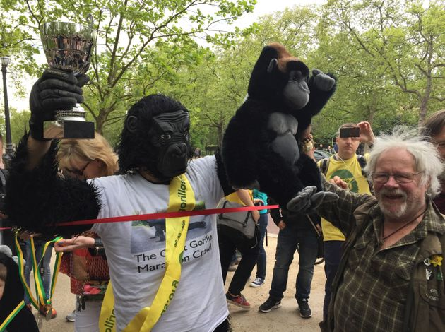 Metropolitan Police officer Tom Harrison, who goes by the name Mr Gorilla, is congratulated by Bill Oddie...