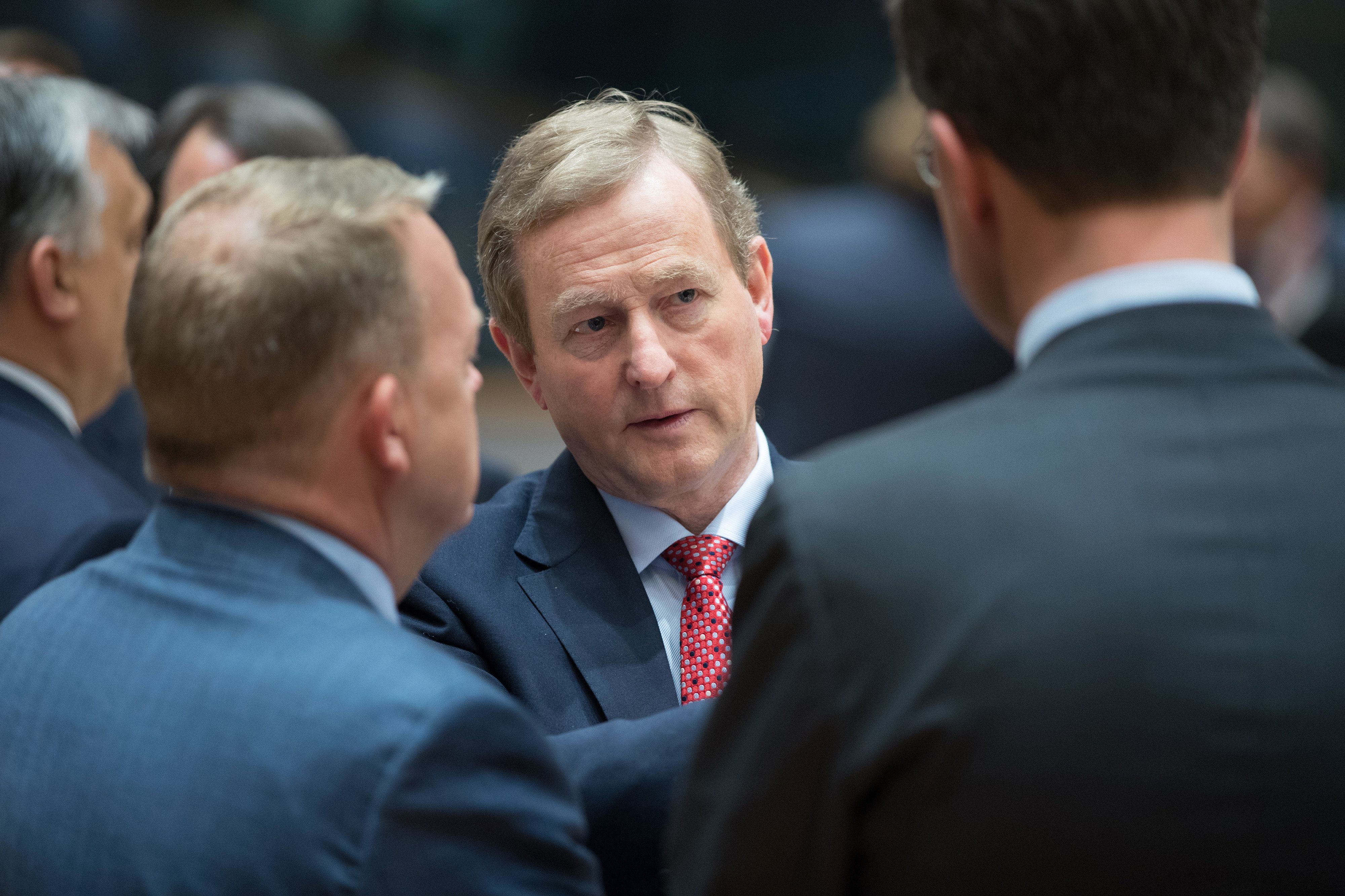 Enda Kenny, Ireland's prime minister, center, talks with Lars Lokke Rasmussen, Denmark's prime minister, left, and Mark Rutte, Dutch prime minister, right, prior to a round table meeting during a European Union (EU) leaders emergency Brexit summit at the Europa building in Brussels, Belgium, on Saturday, April 29, 2017. European Union leaders headed into their first Brexit summit are convinced that when it comes to the pending talks with the U.K. theyre already winning. Photographer: Jasper Juinen/Bloomberg via Getty Images