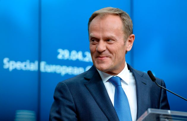 European Union Council President Donald Tusk smiles during a press conference following a Special Meeting...