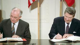 General Secretary Mikhail Gorbachev (left) and US President Ronald Reagan (right) sign the  Intermediate-Range Nuclear Forces Treaty (INF). Washington, White House, December 8, 1987. (Photo by: Photo12/UIG via Getty Images)