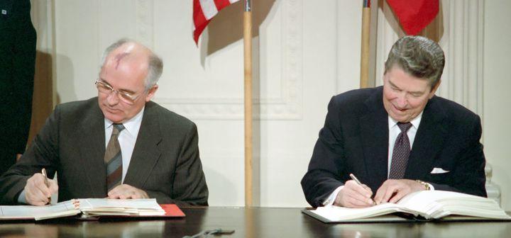 General Secretary Mikhail Gorbachev (left) and U.S. President Ronald Reagan sign the Intermediate-Range Nuclear Forces Treaty