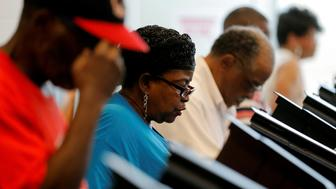 Voters cast their ballots during early voting at the Beatties Ford Library in Charlotte, North Carolina October 20, 2016. REUTERS/Chris Keane