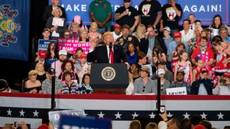 US President Donald Trump (C) speaks during a 'Make America Great Again' rally in Harrisburg, PA, April 29, 2017, marking Trump's 100th day in office. / AFP PHOTO / JIM WATSON        (Photo credit should read JIM WATSON/AFP/Getty Images)
