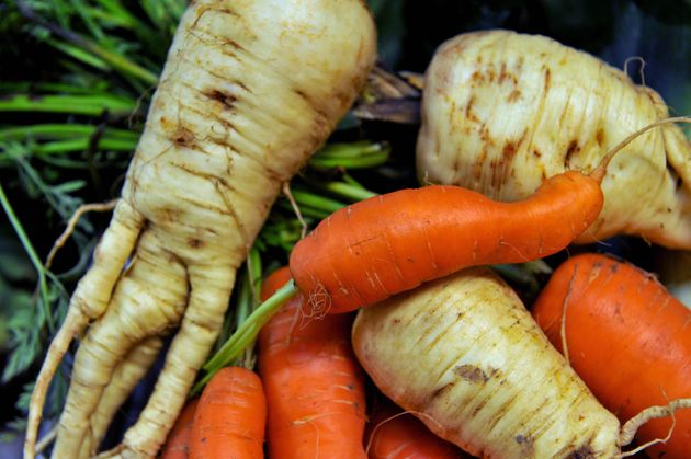 Supermarkets are being urged to sell more wonky fruit and vegetables to tackle the UK's food waste