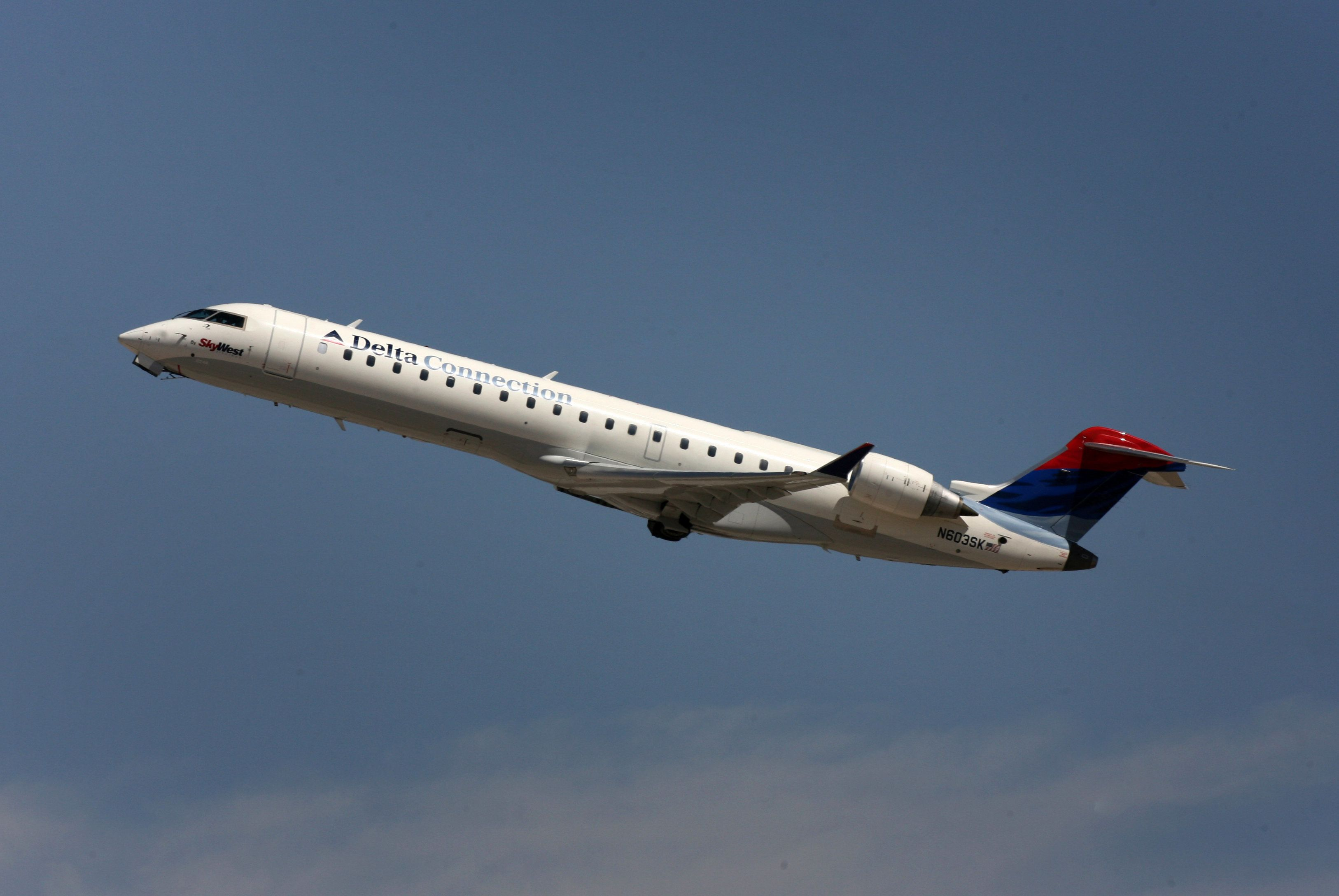 A Delta Connection Airlines jet flies out of Las Vegas Airport in USA