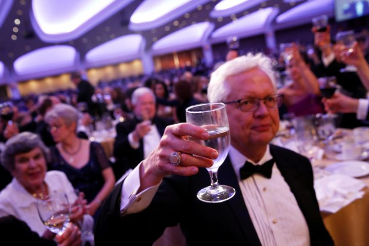 Attendees of the White House Correspondents' Dinner raise a glass to the First Amendment.