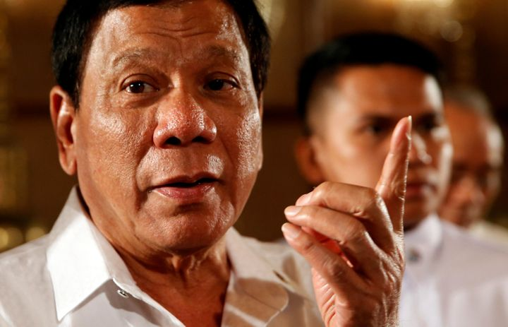 Philippine President Rodrigo Duterte talks to reporters after a news conference at the presidential palace in Manila, Philipp