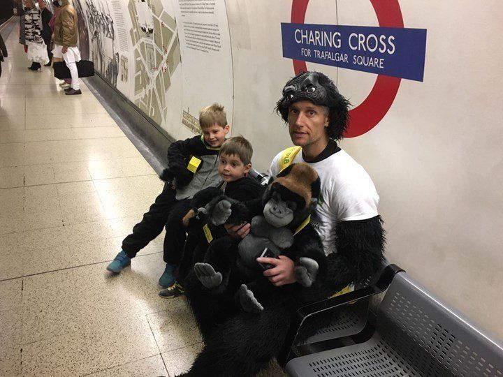 Harrison is seen with his two young sons. The 41-year-old completed the London Marathon on Saturday in a gorilla costume.