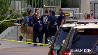 Police and neighbors gather in Universal City area of San Diego after a gunman shot eight people