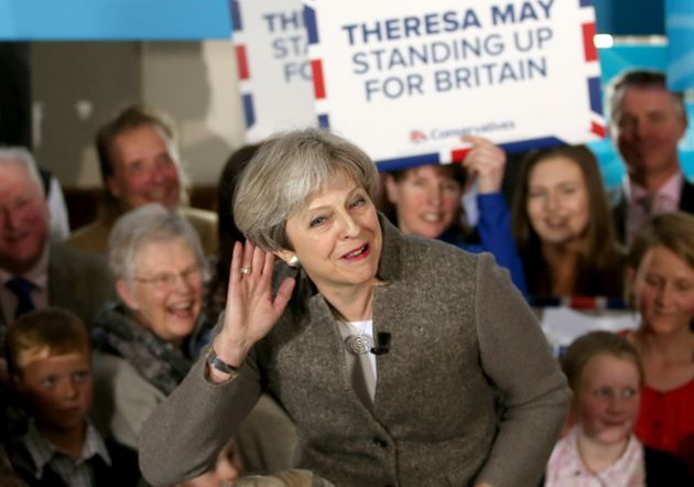 Theresa May delivers a speech while on the election campaign trail in the village of Crathes,