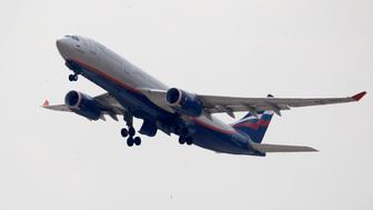 An Aeroflot Airbus A330 plane heading to the Cuban capital Havana takes off at Moscow's Sheremetyevo airport June 27, 2013. A Russian passenger plane left Moscow for Havana on Thursday without any sign of former U.S. spy agency contractor Edward Snowden on board, witnesses said. REUTERS/Sergei Karpukhin (RUSSIA - Tags: POLITICS SOCIETY TRANSPORT)