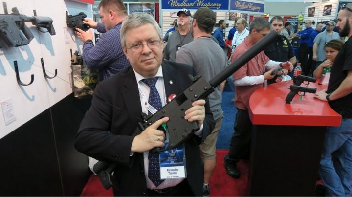 Alexander Torshin samples the wares at the NRA's 2016 annual meeting in Louisville, Kentucky.