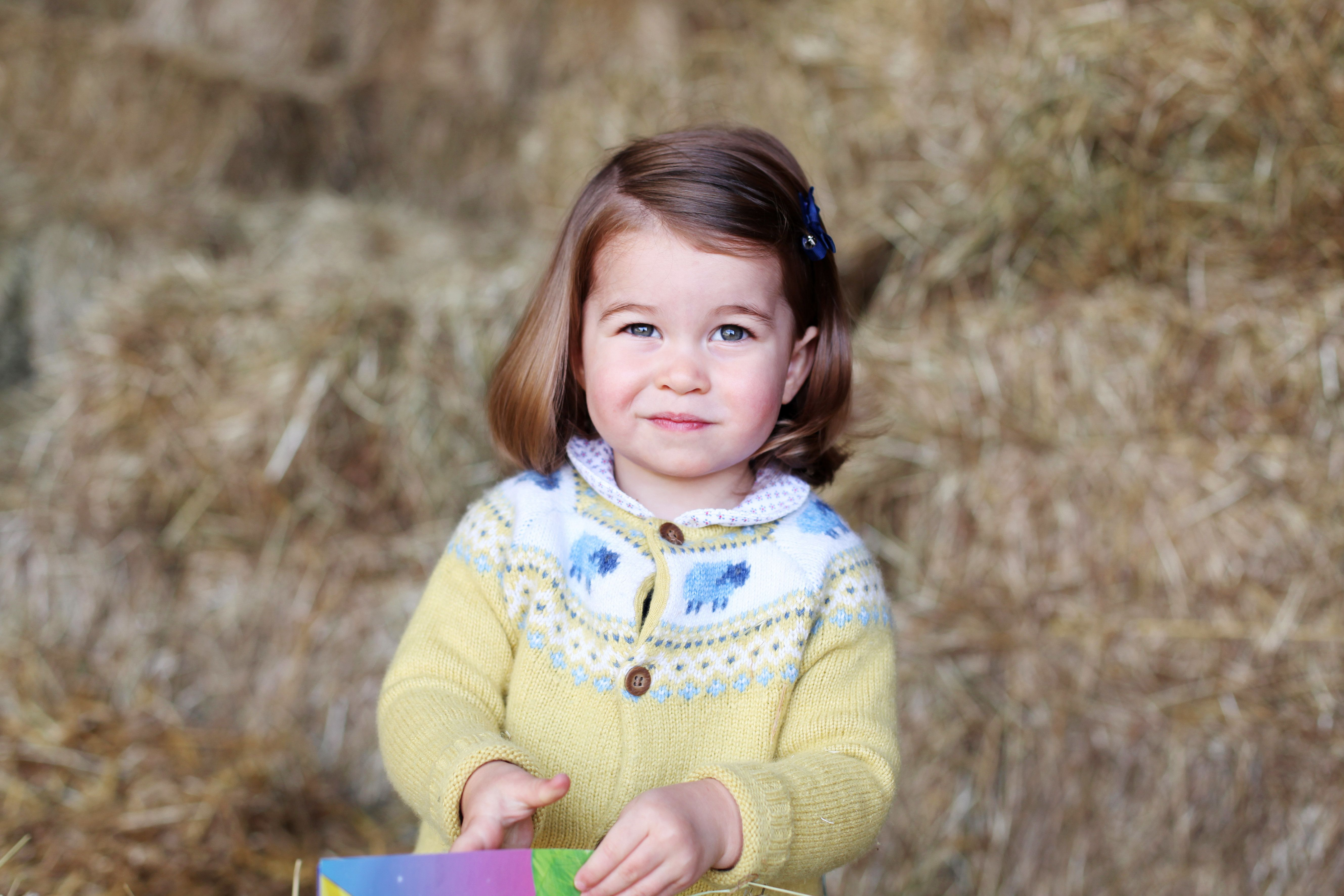 NORFOLK, ENGLAND - APRIL 2017: In this undated handout image released by the Duke and Duchess of Cambridge, Princess Charlotte is pictured at home in April in Norfolk, England. The photograph was taken in April by The Duchess at their home in Norfolk to mark Princess' second birthday. (Photo by HRH The Duchess of Cambridge via Getty Images)  NEWS EDITORIAL USE ONLY. NO COMMERCIAL USE (including any use in merchandising, advertising or any other non-editorial use including, for example, calendars, books and supplements). This photograph is provided to you strictly on condition that you will make no charge for the supply, release or publication of it and that these conditions and restrictions will apply (and that you will pass these on) to any organisation to whom you supply it. All other requests for use should be directed to the Press Office at Kensington Palace in writing.  NOTE TO EDITORS: This handout photo may only be used in for editorial reporting purposes for the contemporaneous illustration of events, things or the people in the image or facts mentioned in the caption. Reuse of the picture may require further permission from the copyright holder.