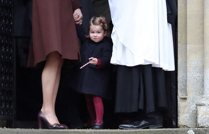 Princess Charlotte holds her mother, Catherine, The Duchess of Cambridge's hand (L) after attending the morning Christmas Day