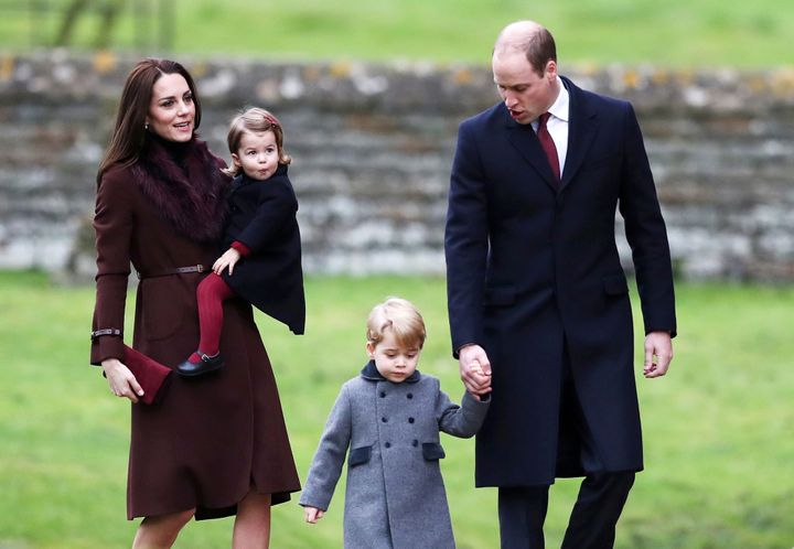 Prince William, the Duke of Cambridge (R), his wife Catherine, The Duchess of Cambridge (L), Prince George (2nd R) and Prince