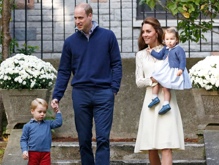 Prince William, Catherine, Duchess of Cambridge, Prince George and Princess Charlotte arrive at a children's party at Governm