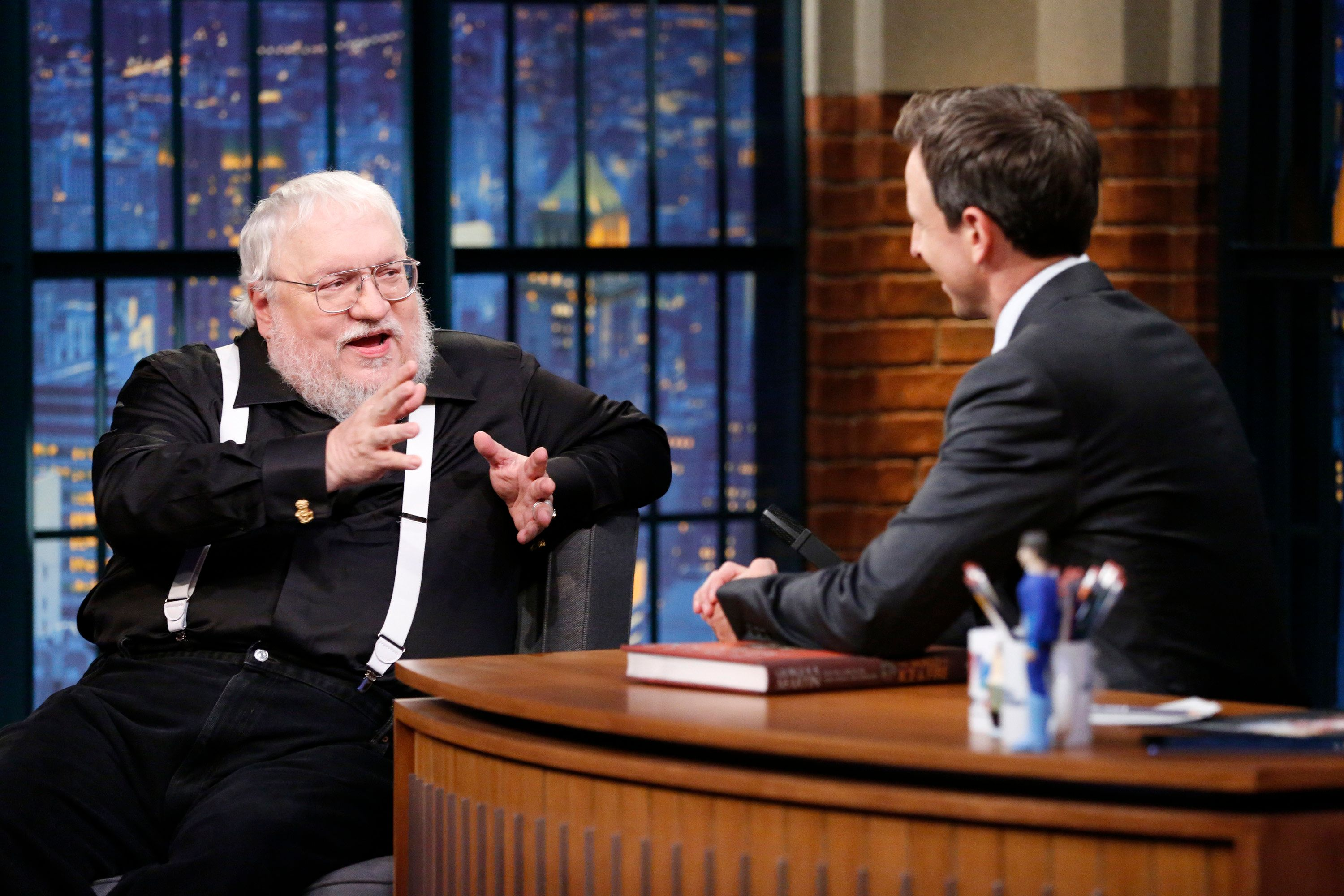 LATE NIGHT WITH SETH MEYERS -- Episode 0117 -- Pictured: (l-r) Author George R.R. Martin during an interview with host Seth Meyers on October 28, 2014 -- (Photo by: Lloyd Bishop/NBC/NBCU Photo Bank via Getty Images)