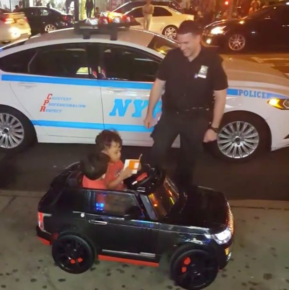 Two toddlers were playfully ticketed by police in New York City after caught driving their Power Wheel on a sidewalk