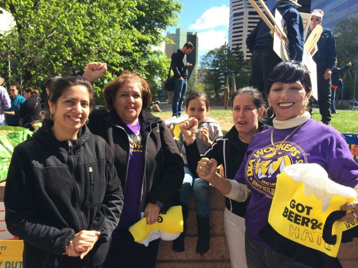 "Eva Martinez, second from right, rallied with other union members in Denver, as protesters chanted, ""Si se puede!"""