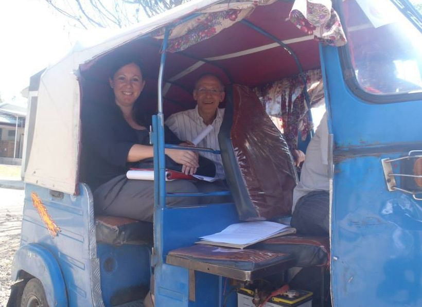 Traveling between household visits by Tuk Tuk.