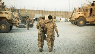 A U.S. soldier from the 3rd Cavalry Regiment walks with the unit's Afghan interpreter before a mission near forward operating base Gamberi in the Laghman province of Afghanistan December 11, 2014. Picture taken December 11, 2014. REUTERS/Lucas Jackson (AFGHANISTAN - Tags: CIVIL UNREST POLITICS MILITARY TPX IMAGES OF THE DAY)