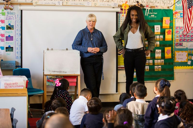 Mrs. Judy Vellegas and former first grade student Venus Williams in Mark Twain Elementary School, Lynwood CA