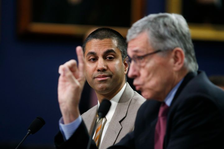 Ajit Pai, then-commissioner of the Federal Communications Commission, listens as then-FCC Chairman Tom Wheeler testifies on C