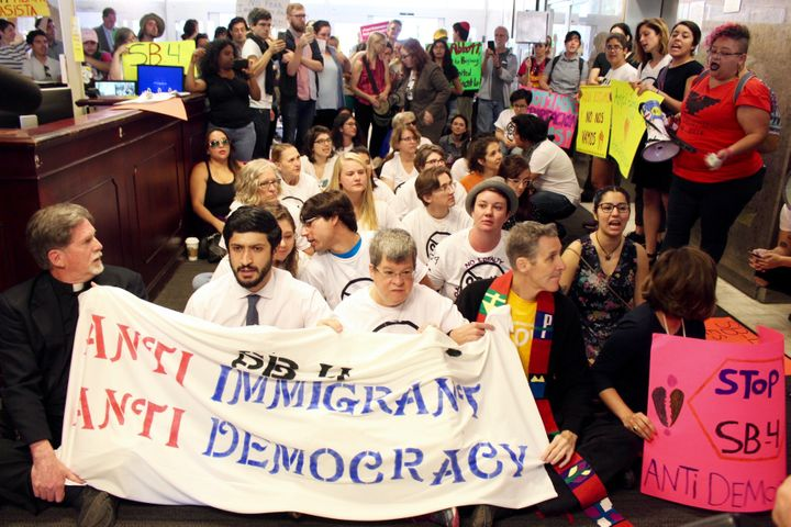 20 people charged after Texas 'sanctuary city' sit