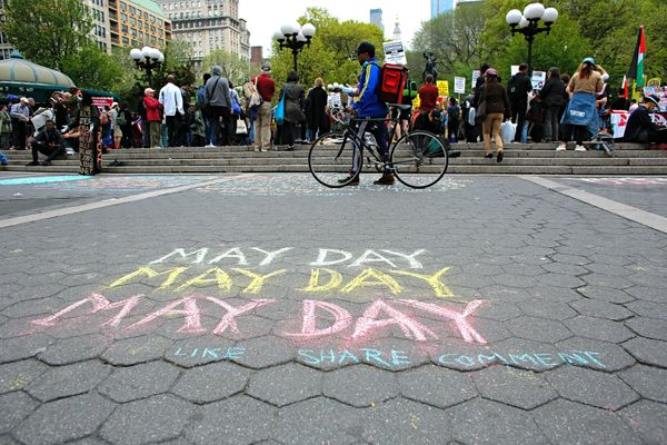 People attend a May day rally in Union Square on May 1, 2017 in New York.