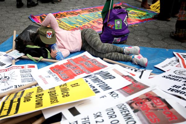 A demonstrator rests among signs during a May Day protest in New York, U.S. May 1, 2017.