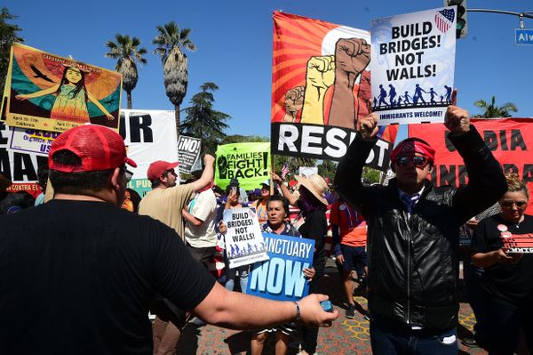 Protesters march against President Donald Trump's immigration policy in Los Angeles, California on May 1, 2017, where tens of