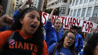 SAN FRANCISCO, CA - MAY 01:  Protesters chant during a May Day demonstration outside of a U.S. Immigration and Customs Enforcement (ICE) office on May 1, 2017 in San Francisco, California.  Thousands are expected to take to the streets across the United States to participate in May Day demonstrations.  (Photo by Justin Sullivan/Getty Images)