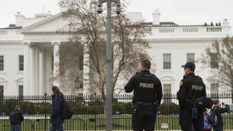 Members of the Secret Service Uniformed Divison patrol alongside the security fence around the perimeter of the White House in Washington, DC, March 18, 2017. A man who scaled a White House fence earlier this month traipsed the grounds of the executive residence for more than 16 minutes prior to his arrest, the US Secret Service said. / AFP PHOTO / SAUL LOEB        (Photo credit should read SAUL LOEB/AFP/Getty Images)
