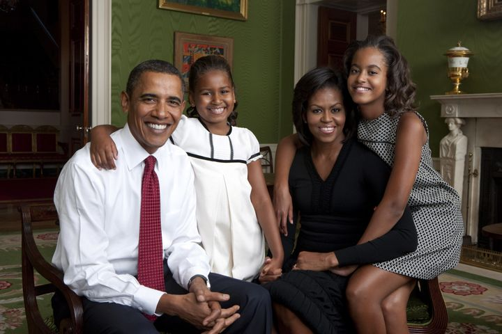 The Obamas pose for a portrait in the Green Room of the White House in 2009.