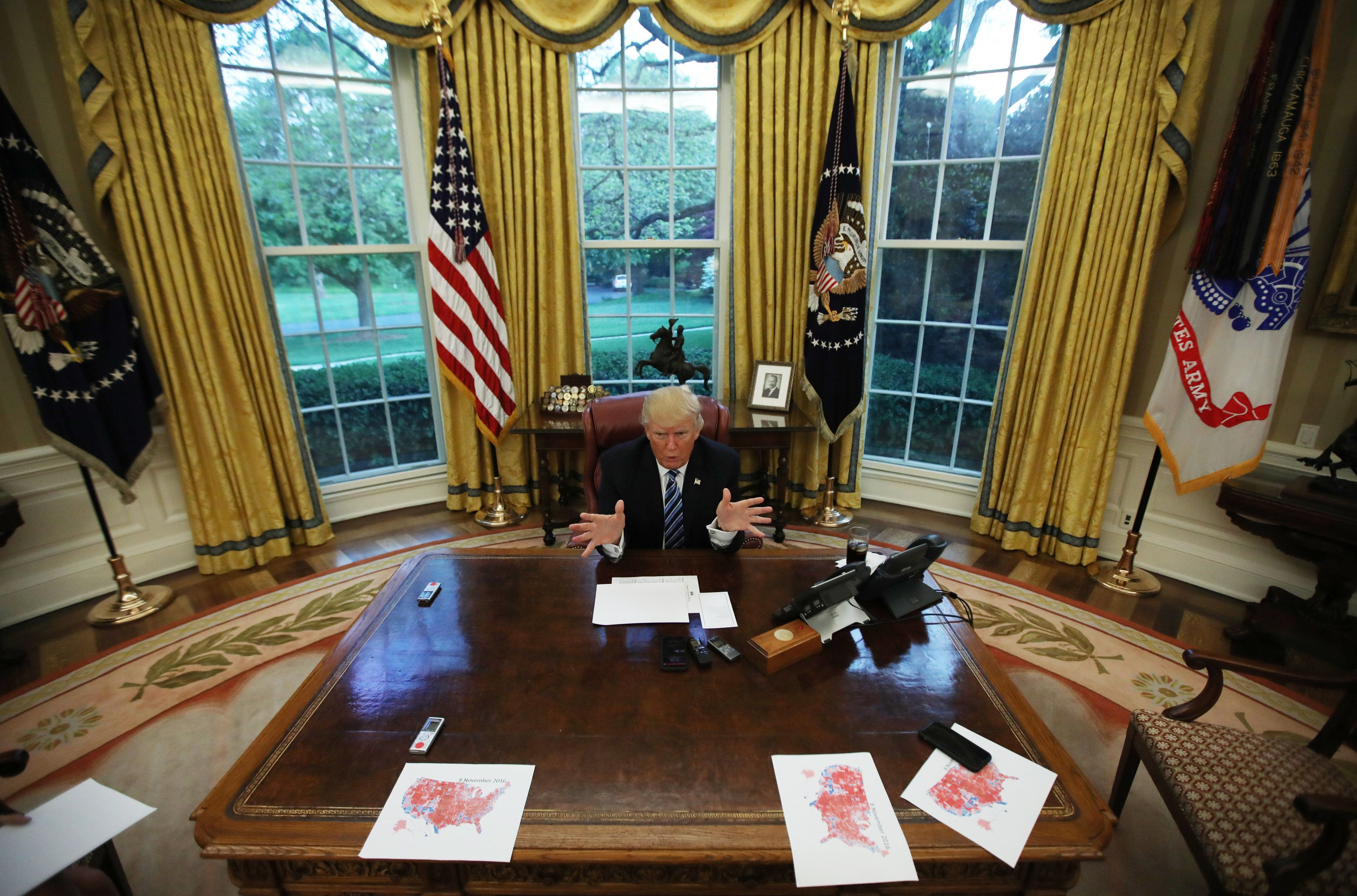 U.S. President Donald Trump speaks during an interview with Reuters in the Oval Office of the White House in Washington, U.S., April 27, 2017. REUTERS/Carlos Barria   TPX IMAGES OF THE DAY