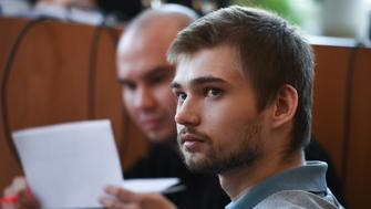 YEKATERINBURG, RUSSIA - MARCH 15, 2017: Blogger Ruslan Sokolovsky (front), accused of extremism and offending religious believers, at a hearing at the Verkh-Isetsky District Court. In August 2016, Sokolovsky filmed himself playing Pokemon Go on his smartphone at the Church on Blood in Honour of All Saints Resplendent in the Russian Land. Donat Sorokin/TASS (Photo by Donat Sorokin\TASS via Getty Images)
