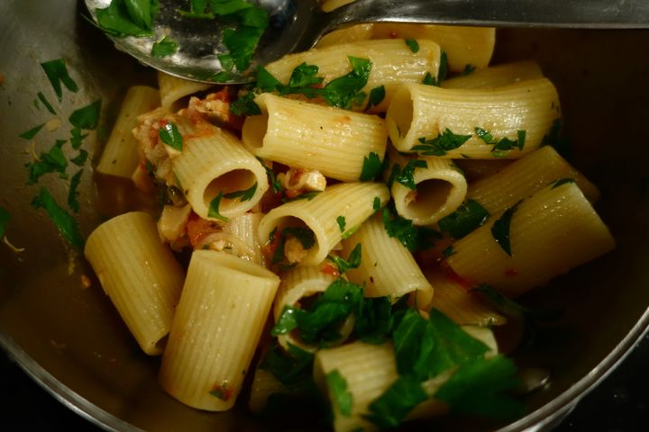 <p>Rigatoni added to the pan, then lots of parsley</p>